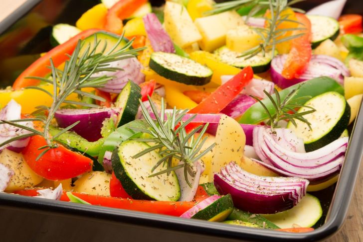 Roasting colorful vegetables, including bell peppers