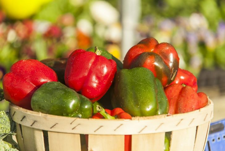 Basket of green and red bell peppers