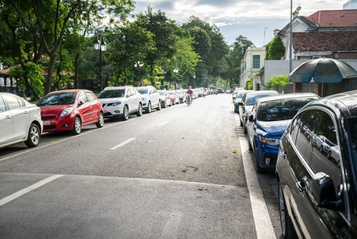 Cars parallel parked along road