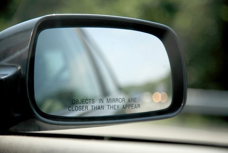 Close-up of car's side mirror