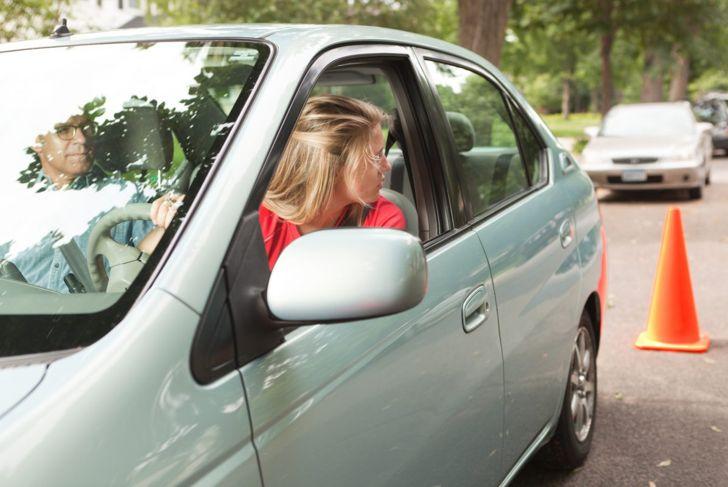 Teen practicing parallel parking