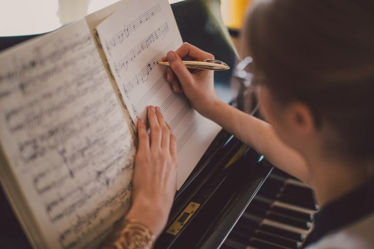 Woman writing musical notation