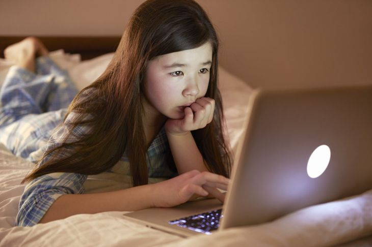 child learning on her computer