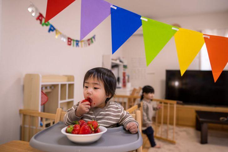 baby eating berries