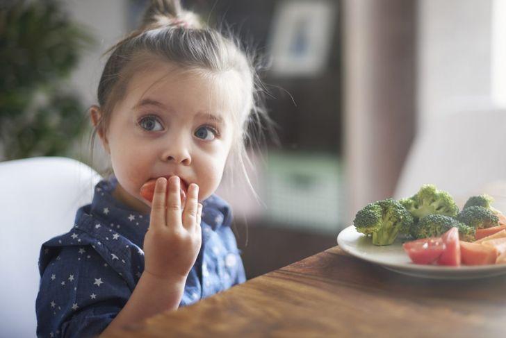 baby eating steamed veggies