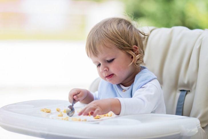 baby eating scrambled eggs