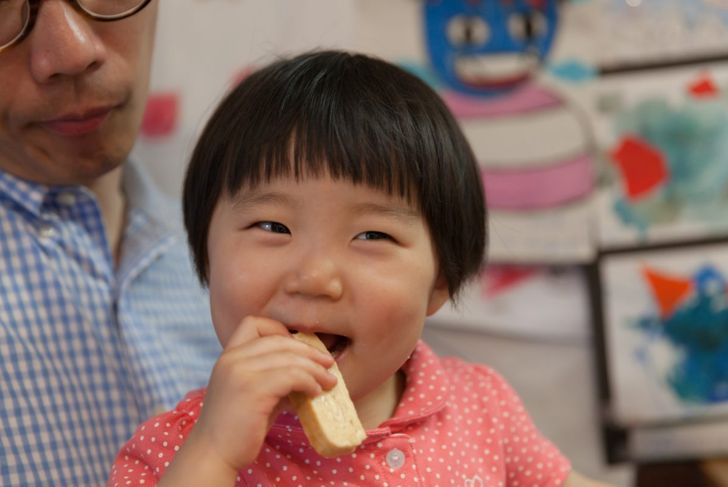toddler with teething biscuit
