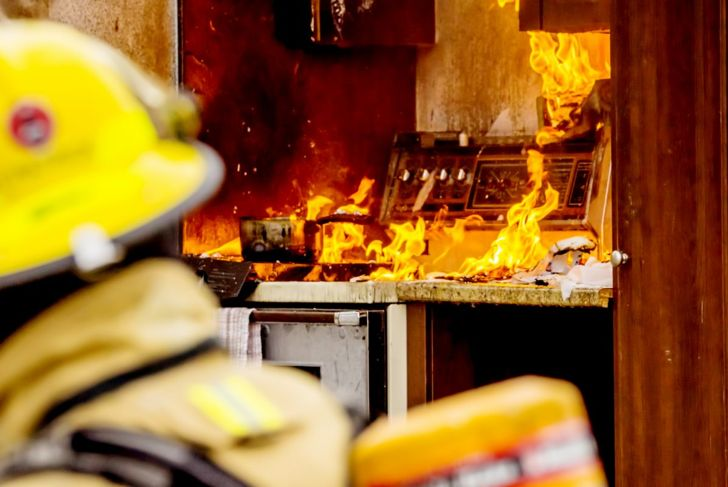 Firefighter in burning kitchen