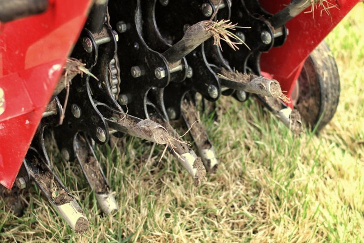 close up of an aerator on a lawn