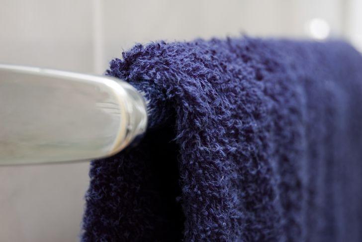 close up of a bath towel on a hanging bar