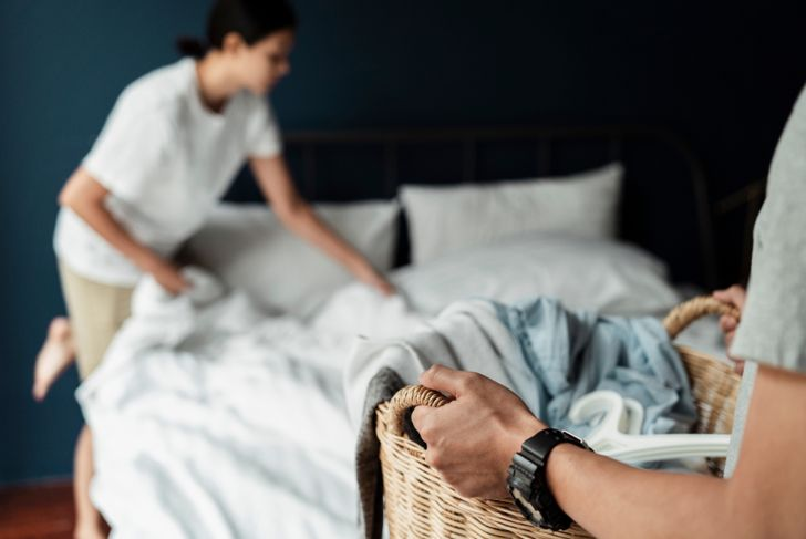 people changing the bed linens, man with wicker basket