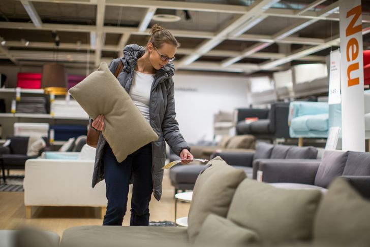 woman looking at couches at a furniture store
