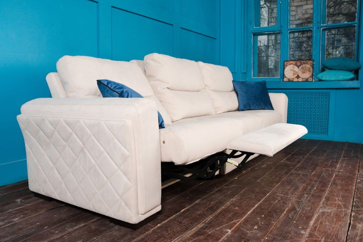 white couch with recliner in a bright blue room