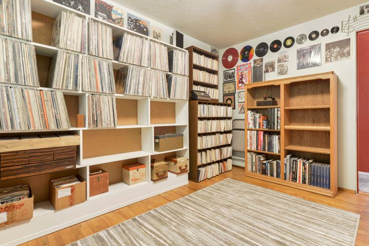 music room with rows of records and album cover art