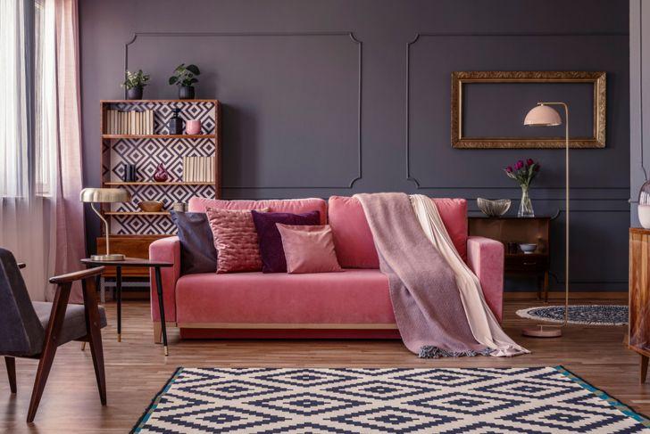 bold living room with matching rug and bookshelf