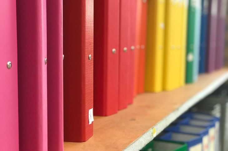 rows of color-coded binders