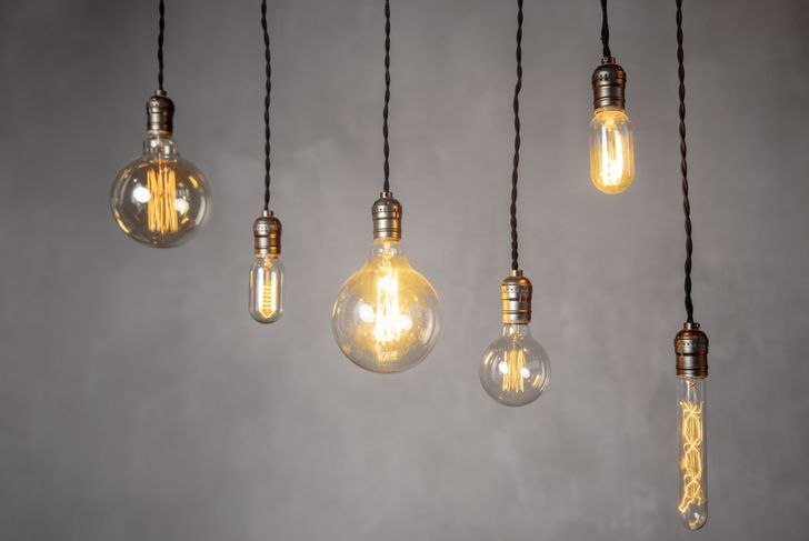 a row of old-fashioned lightbulbs of different shapes