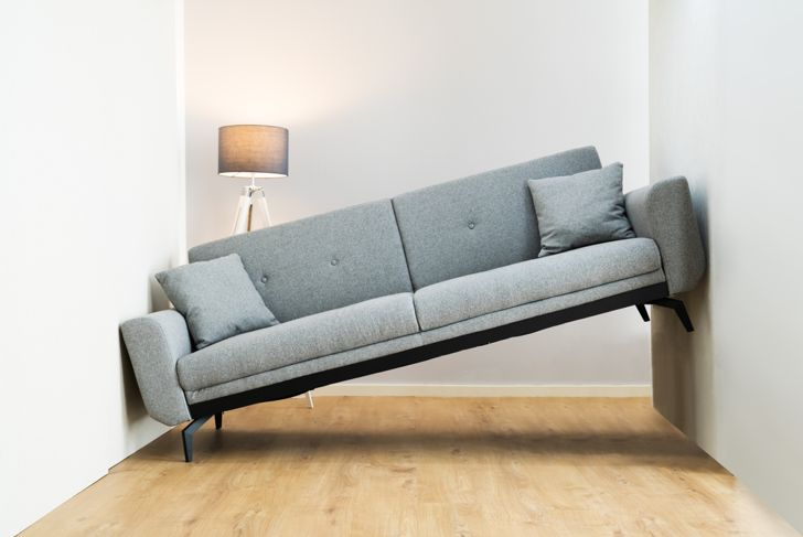 couch doesn't fit in living room, leaning against wall