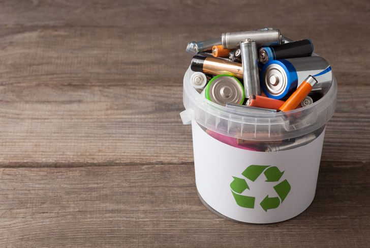 close up of batteries in a recycling basket