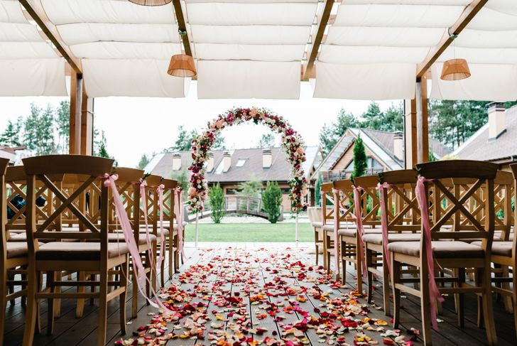 beautiful wedding ceremony space with rose petals