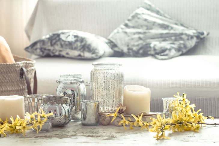 candles in a bright, rustic living room setting