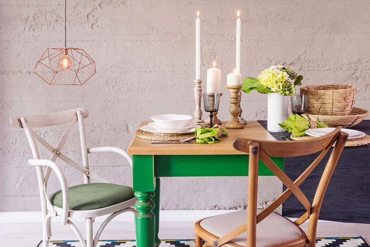 colorful, mismatched table setting with candles