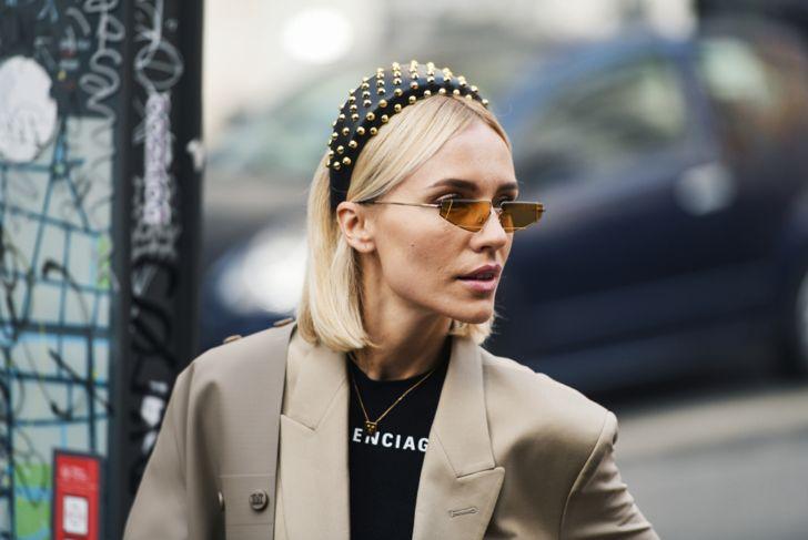 woman wearing studded headband and sunglasses