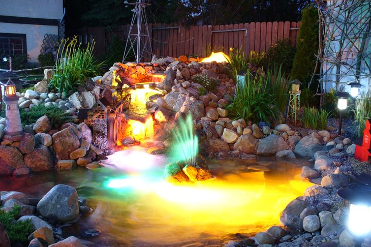 pond at night with underwater lights