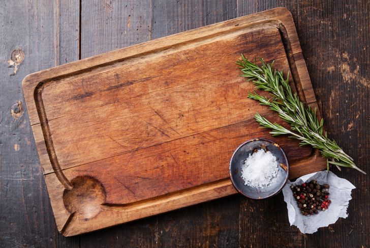 quality wood cutting board with herbs