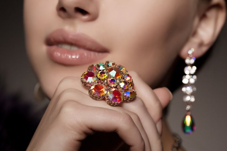 woman wearing a vintage ring and earrings