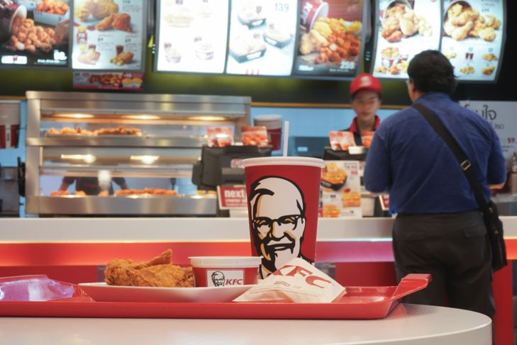 person ordering food at a KFC restaurant