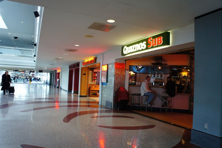 a Quiznos restaurant in an airport