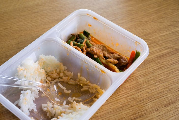 stained plastic container with leftovers